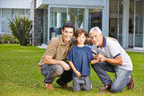 Child with father and grandfather in garden