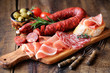 Spanish tapas - chorizo, salsichon, jamon serrano, lomo and olives