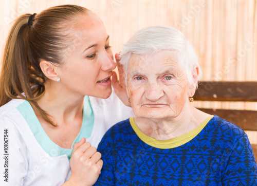 Leinwanddruck Bild Elderly woman with caregiver