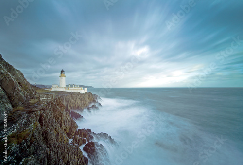 Long Exposure Storm Sea Lighthouse Cliffs - 101069344