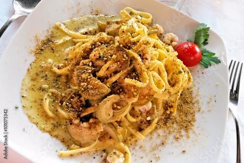 Canvastavla Traditional Italian tagliatelle pasta dish with creamy pistachio pesto, zucchini