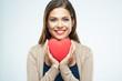 Obrazy na płótnie, fototapety, zdjęcia, fotoobrazy drukowane : Beautiful woman hold red heart. Valentine day love concept.