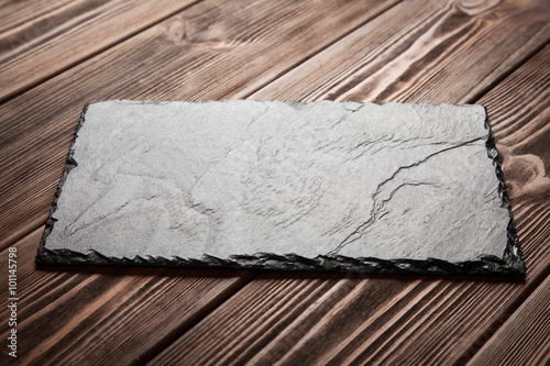 Slate board on wood