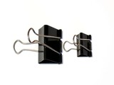 Paper binder clips on white background