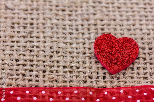 ein rotes herz liegt auf stoff fotos de archivo e im genes libres de derechos en. Black Bedroom Furniture Sets. Home Design Ideas