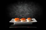 Three sushi on black