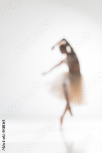 Blurred silhouette of ballerina on white background Plakát