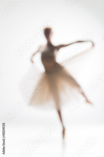Blurred silhouette of ballerina on white background плакат