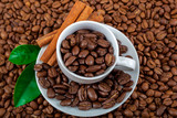 Coffee beans with cinnamon as a background
