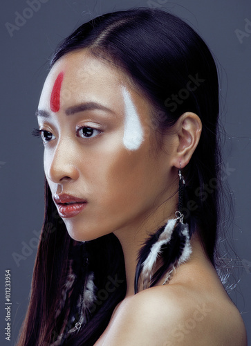 Poster beauty young asian girl with make up like Pocahontas, red indians woman fashion,