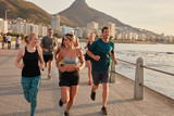 Fototapety Fit young runners training on seaside promenade