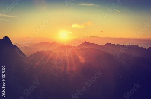 Summer mountain landscape at sunset. Sun and peaks in High Tatra Mountains, Poland.