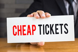 Cheap ticket, message on white card and hold by