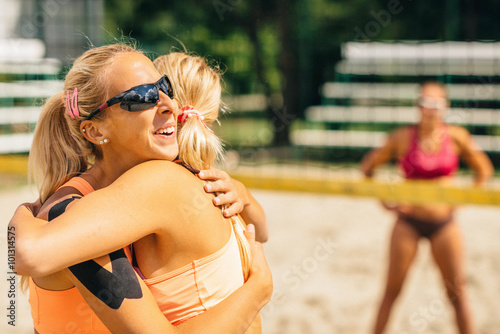 Girls scoring a point in beach volleyball Poster