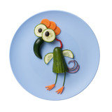 Funny bird made of vegetables on blue plate