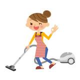 掃除機をする主婦