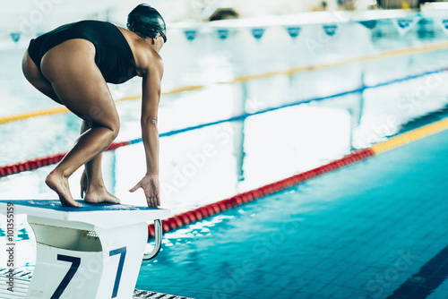 Poster, Tablou Freestyle swimming race start, swimmer on the starting block