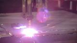 Industrial laser is cutting a steel sheet