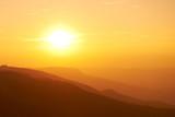 Fototapety Beautiful sunset at the mountains.