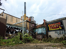 "Постер, картина, фотообои ""Urban ghetto in the alley with graffiti - landscape photo"""