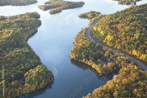 Fototapeta Curving road along Mississippi River during autumn