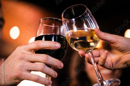 Poster, Tablou Close up of friends toasting with wine