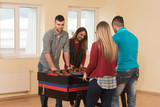 Friends Playing Soccer Table - Foosball