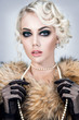 Beautiful woman portrait in retro style with fur and pearls on neck