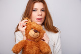 red-haired girl with a teddy bear