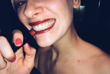 Woman smile with red lips and lipstick at party