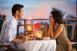 Couple sharing romantic sunset dinner
