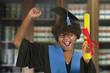 woman celebrating graduation with diploma