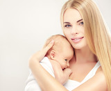 Portrait happy mother and baby . Smiling Woman with her newborn baby