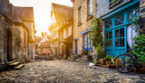 Old town in Europe at sunset with retro vintage Instagram style filter and lens flare effect - Fine Art prints