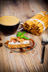 Cup of coffee and dessert on wooden background