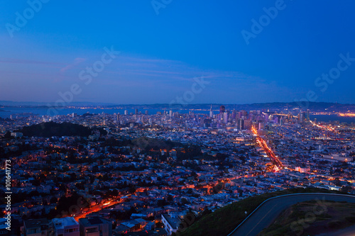 Evening view of San Francisco downtown and houses Poster