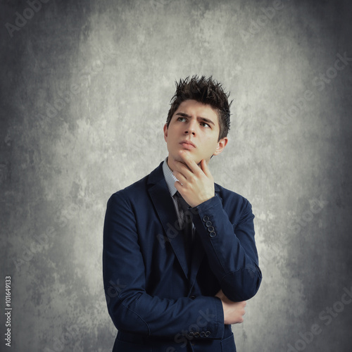 Poster Young thoughtful businessman