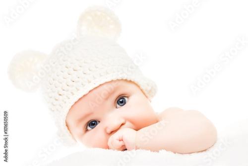 fototapeta na ścianę Baby wearing a knit hat with bear ears