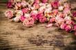 Obrazy na płótnie, fototapety, zdjęcia, fotoobrazy drukowane : Closeup of dried roses on wooden background