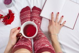 Woman having a cup of tea in bed