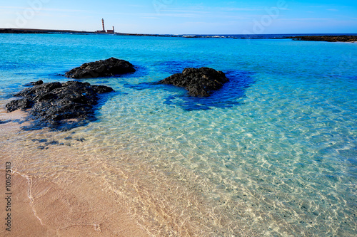 Deurstickers Canarische Eilanden El Cotillo beach Toston lighthouse Fuerteventura