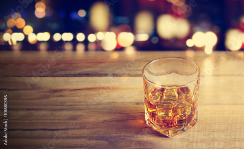 Whiskey drink on wooden background