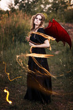 Witch with wings and snake