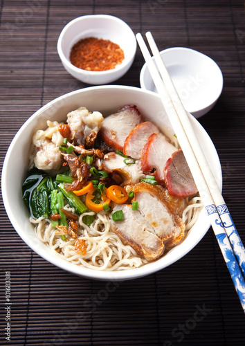 Juliste noodle with crispy pork and sliced fried pork,thai food