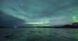 Northern lights on a frozen beach