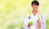 Doctor woman with dumbbell and apple.