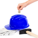 hard hat as piggy bank, glove and hammer - isolated on white