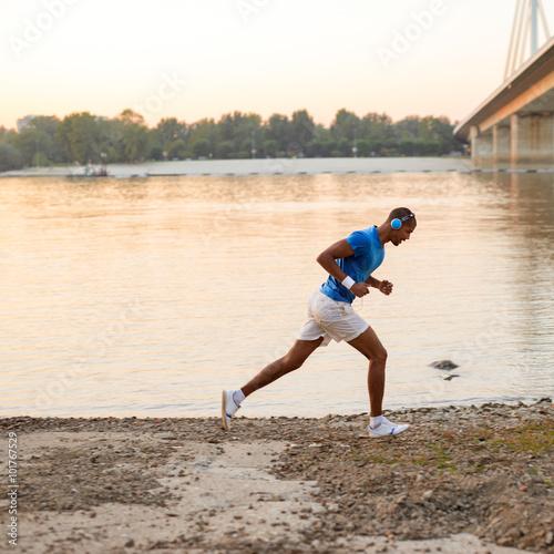 Fototapeta Morning run next to the river