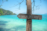 Walk this way sign on the beach with sea at koh wai, trat, thail