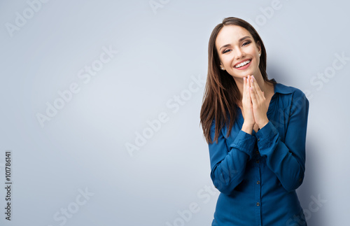happy gesturing smiling young woman, with copyspace